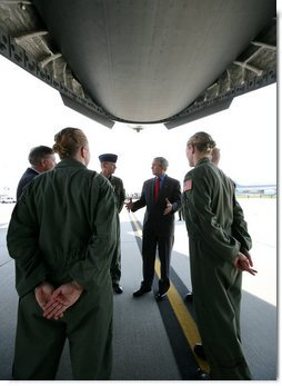 President George W. Bush meets with military personnel prior to boarding a C-17 aircraft to watch cargo loading operations Tuesday, July 24, 2007, during a visit to Charleston AFB in Charleston, S.C. White House photo by Eric Draper