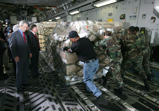 President George W. Bush, joined by South Carolina Senator Lindsey Graham, watches as USAF military personnel conduct cargo loading operations aboard a C-17 aircraft Tuesday, July 24, 2007, during a visit to Charleston AFB in Charleston, S.C. White House photo by Eric Draper
