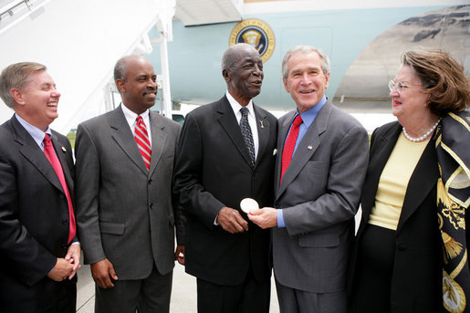 President George W. Bush presents the Congressional Gold Medal to Tuskegee Airman Earl Middleton Tuesday, July 24, 2007, joined by Middleton's son, Kenny; South Carolina Senator Lindsey Graham, left, and Middleton family friend Joy Barnes, right, at the Charleston AFB in Charleston, S.C. White House photo by Eric Draper