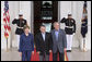 President George W. Bush and Mrs. Laura Bush welcome Jordan's King Abdullah II to the White House Tuesday evening, July 24, 2007, for a social dinner. White House photo by Shealah Craighead