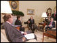 President George W. Bush meets with co-chairs of the President's Commission on Care for America's Returning Wounded Warriors, former Health and Human Services Secretary Donna Shalala and former Senator Bob Dole, left, Wednesday, July 25, 2007, joined by outgoing Veterans Affairs Secretary Jim Nicholson in the Oval Office at the White House.  White House photo by Joyce N. Boghosian