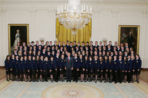 President George W. Bush joins the National and State Future Farmers of America organization members for photo Thursday, July 26, 2007, in the East Room of the White House. The mission of the FFA is to help students develop their potential for leadership, personal growth and career success through agricultural education. White House photo by Joyce N. Boghosian