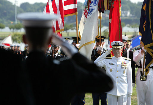 "Admiral Edmund P. Giambastiani, Jr. returns a salute from Chairman of the Joint Chiefs of Staff General Peter Pace, Friday, July 27, 2007, during a retirement ceremony for Giambastiani at the Naval Academy in Annapolis, Md. ""On the 3rd of June, 1970, Edmund Giambastiani, Jr. became an officer -- raising his right hand and swearing to defend the Constitution of the United States against all enemies, foreign and domestic,"" said Vice President Dick Cheney during the ceremony, adding, ""He has been faithful to that oath, and he has earned the satisfaction of this moment. We honor this leader of distinction for his 37 years of commissioned service; for his lifetime of achievement; and for the sterling example he leaves to us all."" White House photo by David Bohrer"