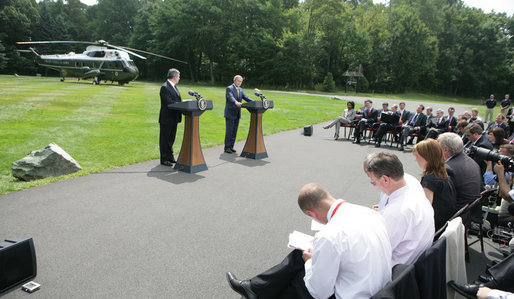 President George W. Bush and British Prime Minister Gordon Brown address the press Monday, July 30, 2007, at Camp David near Thurmont, Md. White House photo by Eric Draper