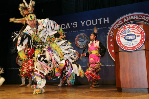 Members of the Three Affiliated Tribes Youth Dance Troupe perform at the Helping America's Youth Fourth Regional Conference in St. Paul, Minn., Friday, August 3, 2007. The dancers, ranging in age from 10 to eighteen, showcased six styles of Plains Powwow Dancing. Each style of dance represents a specific history and tells a story of American Indian culture. A segment of the conference addressed the unique challenges facing tribal youth. White House photo by Chris Greenberg