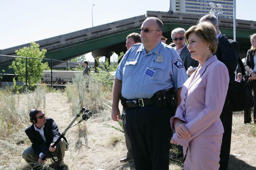 Mrs. Laura Bush surveys the wreckage of the I-35W bridge collapse with Deputy Chief of Police Robert 'Rob' Allen in Minneapolis, Friday,Aug. 3, 2007. Mrs. Bush also visited an Emergency Operation Command Center and met with volunteers and first responders. White House photo by Chris Greenberg