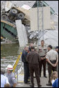 President George W. Bush talks with rescue workers and local and state law enforcement officials during a tour of the Interstate 35W bridge collapse scene in Minneapolis, Saturday, Aug. 4, 2007, where President Bush praised the work of first responders, local authorities and investigators in their response to the tragic bridge collapse. White House photo by Chris Greenberg