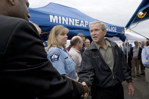 President George W. Bush greets and thanks Minneapolis-St. Paul first responders, National Transportation Safety Board personnel, Minneapolis Police and Fire/Rescue teams, and American Red Cross Twin Cities Area Chapter staff and volunteers, for their hard work at the scene of the I-35W bridge collapse Saturday, Aug. 4, 2007 in Minneapolis. White House photo by Chris Greenberg