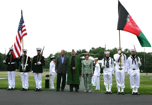 President George W. Bush and Mrs. Laura Bush stand with President Hamid Karzai of Afghanistan during an arrival ceremony at Camp David, Sunday, August 5, 2007. White House photo by Chris Greenberg