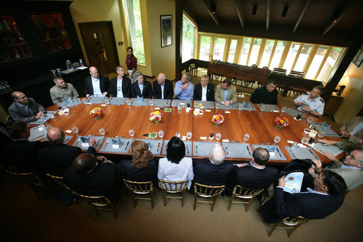 President George W. Bush meets for lunch with the Secretary of Defense, Defense Policy and Programs Team and Secretary of State and Foreign Policy Team Tuesday, Aug. 7, 2007, at Camp David. Of those photographed, Vice President Dick Cheney is seated at the President's right, Defense Secretary Robert Gates and State Secretary Condoleezza Rice are seated in front of the President. White House photo by Eric Draper