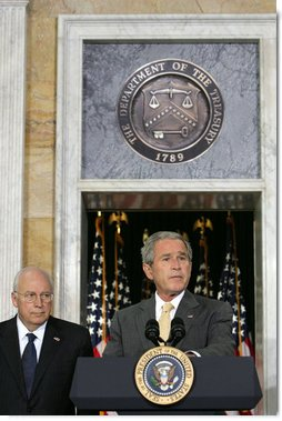 "President George W. Bush stands with his economic advisors as he delivers a statement to the press Wednesday, Aug. 8, 2007, at the U.S. Department of Treasury in Washington, D.C. ""We discussed our thriving economy and what we need to do to keep it that way,"" said President Bush. ""We care a lot about whether our fellow citizens are working, and whether or not they've got money in their pockets to save, spend, or invest as they see fit."" White House photo by Chris Greenberg"
