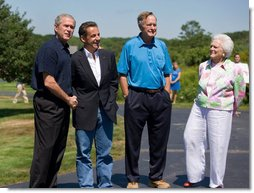 President Nicolas Sarkozy of France is welcomed to Walker's Point by President George W. Bush, former President George H.W. Bush and his wife Barbara Bush Saturday, August 11, 2007, in Kennebunkport, Maine. White House photo by Shealah Craighead