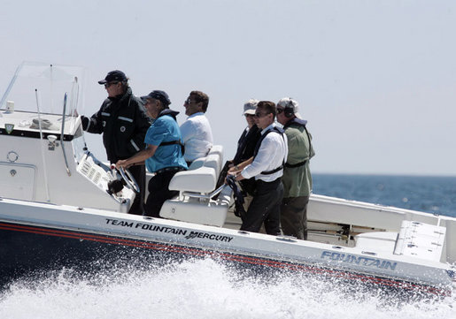 President George W. Bush and President Nicolas Sarkozy of France ride in a boat driven by former President George H. W. Bush during a visit to Walker's Point Saturday, August 11, 2007, in Kennebunkport, Maine. White House photo by Joyce N. Boghosian