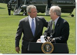 "President George W. Bush puts his hand on the shoulder of Karl Rove Monday, August 13, 2007, after the longtime Deputy Chief of Staff and Senior Advisor announced his resignation during a statement on the South Lawn. In thanking Mr. Rove for his service and friendship, the President said, "". I thank my friend. I'll be on the road behind you here in a little bit."" White House photo by Joyce N. Boghosian"