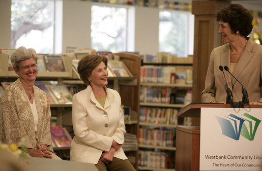 Mrs. Laura Bush is introduced by Texas Comptroller Susan Combs during a visit Tuesday, August 14, 2007, to the Westbank Community Library in Austin, where the construction of the Laura Bush Community Library was announced. The library will be the first public library in the United States to be named for Mrs. Bush, a former teacher and librarian. Joining them is Beth Fox, head librarian at the Westbank library. White House photo by Shealah Craighead