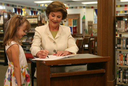 five year old reese granddaughter of the head librarian watches as mrs laura bush signs the childrens book bumblebee bumblebee do you know me. Resume Example. Resume CV Cover Letter