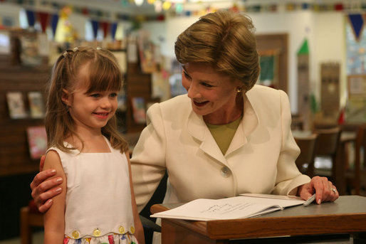Five-year-old Reese stands with Mrs. Laura Bush at the Westbank Community Library in Austin during the announcement Tuesday, Aug. 14, 2007, of the Laura Bush Community Library. The library is the first public library in the United States to be named for Mrs. Bush, a former teacher and librarian. White House photo by Shealah Craighead