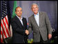 President George W. Bush exchanges handshakes with Mexico's President Felipe Calderon Monday, Aug. 20, 2007, as they met for a bilateral discussion during the North American Leaders' Summit in Montebello, Canada. White House photo by Eric Draper