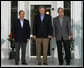 President George W. Bush stands with Mexican President Felipe Calderon, left, and Canadian Prime Minister Stephen Harper upon their arrival for dinner Monday, Aug. 20, 2007, during the North American Leaders' Summit at the Fairmont Le Chateau Montebello in Montebello, Canada. White House photo by Chris Greenberg