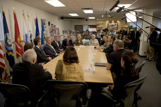 President George W. Bush is joined by Minnesota Governor Tim Pawlenty, U.S. Senator Amy Klobuchar, Minneapolis Mayor R.T. Rybak and other federal, state and local officials, at a briefing Tuesday, Aug. 21, 2007 at the Minneapolis/St. Paul Air Reserve Station, on the recovery efforts at the I-35W bridge collapse site and the flash flooding in southeastern Minnesota. White House photo by Chris Greenberg