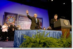 President George W. Bush waves to the crowd as he is introduced by Veterans of Foreign Wars National Commander Gary Kurpius Wednesday, Aug. 22, 2007, to the Veterans of Foreign Wars National Convention in Kansas City, Mo. White House photo by Chris Greenberg