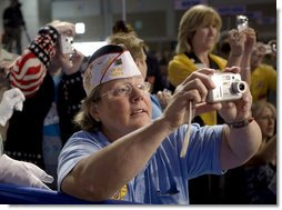 Audience members take photos of President George W. Bush, as he delivers his remarks Wednesday, Aug. 22, 2007, to the Veterans of Foreign Wars National Convention in Kansas City, Mo. White House photo by Chris Greenberg