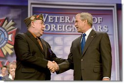 President George W. Bush shakes hands with Veterans of Foreign Wars National Commander Gary Kurpius following the President's address Wednesday, Aug. 22, 2007, to the Veterans of Foreign Wars National Convention in Kansas City, Mo. White House photo by Chris Greenberg