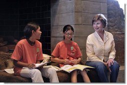 "Mrs. Laura Bush talks with two girls participating in the park's Junior Ranger program at Grand Teton National Park Aug. 27, 2007, in Moose, Wyo. ""Here in Wyoming, the parks introduce young people both to the natural world, and to their history, the history of their own state,"" said Mrs. Bush during her remarks. White House photo by Shealah Craighead"