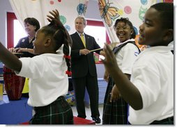 President George W. Bush and Louisiana Governor Kathleen Blanco, left, play musical instruments during a children's program at the Dr. Martin Luther King Jr. Charter School for Science and Technology, Wednesday, Aug. 29, 2007, in New Orleans. White House photo by Chris Greenberg