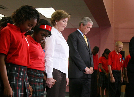 President George W. Bush and Mrs. Laura Bush join students and facility at the Dr. Martin Luther King Jr. Charter School for Science and Technology in a moment of silence marking the second anniversary of Hurricane Katrina, Wednesday, Aug. 29, 2007, in New Orleans. White House photo by Shealah Craighead