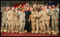 President George W. Bush greets troops on stage after his remarks at Al Asad Airbase, Al Anbar Province, Iraq, Monday, September 3, 2007. White House photo by Eric Draper