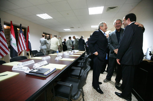 President George W. Bush greets Iraqi Prime Minister Nouri al Maliki, right, before the start of his meeting with the Iraqi National Leadership at Al Asad Airbase, Al Anbar Province, Iraq, Monday, September 3, 2007. White House photo by Eric Draper
