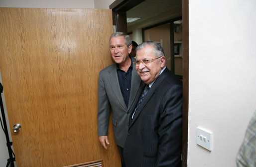 President George W. Bush escorts Iraqi President Jalal Talabani before the start of his meeting with the Iraqi National Leadership at Al Asad Airbase, Al Anbar Province, Iraq, Monday, September 3, 2007. White House photo by Eric Draper