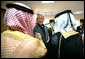 President George W. Bush greets local leaders of Al Anbar Province before their meeting at Al Asad Airbase, Al Anbar Province, Iraq, Monday, September 3, 2007. White House photo by Eric Draper