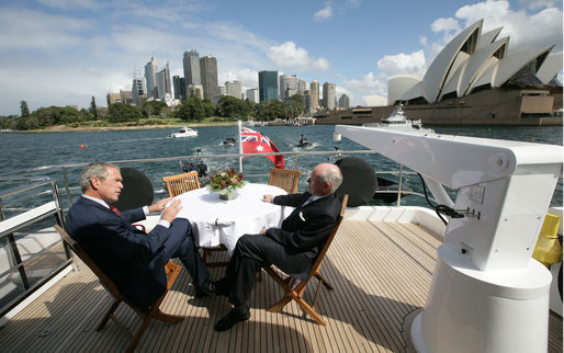 President George W. Bush and Prime Minister John Howard of Australia, sit topside aboard the Age Quod Agis during a tour of Sydney Harbour Wednesday, Sept. 5, 2007. White House photo by Eric Draper