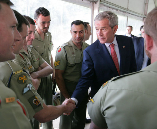 President George W. Bush talks with a member of the Australian Defense Force during a luncheon at the Royal Australia Navy Heritage Centre Wednesday, Sept. 5, 2007, on Garden Island in Sydney Harbour. White House photo by Eric Draper