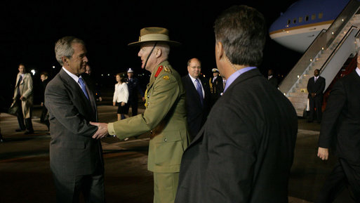 President George W. Bush is greeted Tuesday, Sept. 4, 2007, upon his arrival at Sydney (Kingsford-Smith) Airport by Colonel Bil Monfrieds ADC, representing the Governor-General of Australia. White House photo by Eric Draper