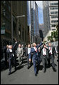 President George W. Bush and Prime Minister John Howard, of Australia, wave to well-wishers Wednesday, Sept. 5, 2007, after leaving the Commonwealth Parliament Offices and walking to the InterContinental Hotel in Sydney. White House photo by Eric Draper