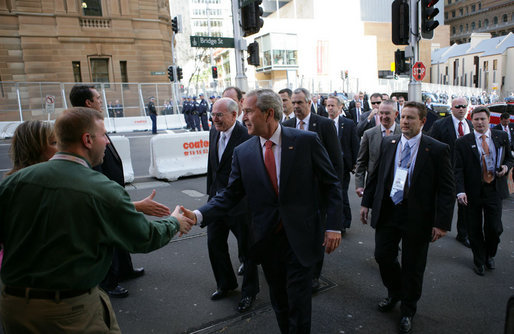 President George W. Bush shakes hands with an unidentified couple Wednesday, Sept. 5, 2007, as he walks to the InterContinental Hotel in Sydney with Prime Minister John Howard of Australia, following their morning meetings. White House photo by Eric Draper