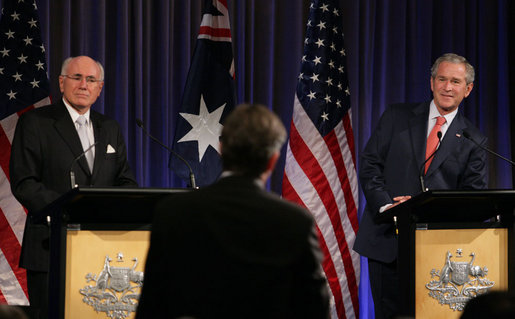 President George W. Bush and Prime Minister John Howard of Australia, listen to a reporter's question Wednesday, Sept. 5, 2007, during a joint press availability at the InterContinental Hotel in Sydney. President Bush met with the Prime Minister for a day's worth of meetings before joining him during the 2007 APEC summit later in the week. White House photo by Eric Draper