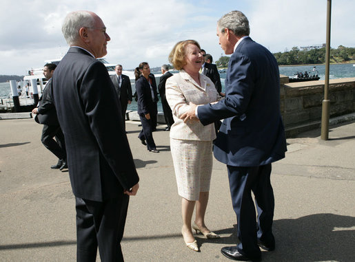 President George W. Bush greets Mrs. Janette Howard at the Man O War Steps Wharf in Sydney Wednesday, Sept. 5, 2007. The President joined Mrs. Howard and Prime Minister Howard for a social lunch with Australian troops. White House photo by Eric Draper