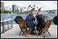 With the Sydney Opera House as a backdrop, President George W. Bush and Prime Minister John Howard of Australia, talk as they tour Sydney Harbour Wednesday, Sept. 5, 2007, aboard the MV AQA. White House photo by Eric Draper
