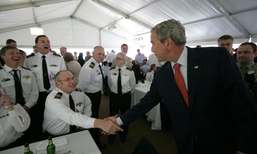President George W. Bush greets Australian troops during a social lunch Wednesday, Sept. 5, 2007, on Garden Island in Sydney. White House photo by Eric Draper