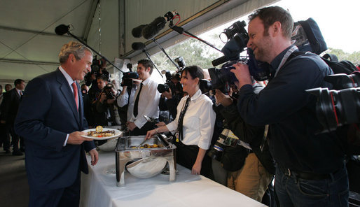 President George W. Bush smiles as he greets a young lady during a luncheon Wednesday, Sept. 5, 2007, on Garden Island in Sydney. White House photo by Chris Greenberg