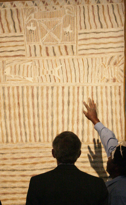 President George W. Bush examines the details of a Yirrkala Bark Painting during a tour Thursday, Sept. 6, 2007, of the Australian National Maritime Museum in Sydney, where the President is scheduled to attend the 2007 APEC summit later this week. White House photo by Eric Draper