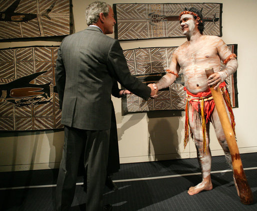 President George W. Bush greets a performer Thursday, Sept. 6, 2007, during a brief exhibition of Aboriginal dance and song at the Australian National Maritime Museum in Sydney. White House photo by Eric Draper