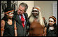 President George W. Bush hugs a young girl Thursday, Sept. 6, 2007, following a performance of Aboriginal song and dance at the Australian National Maritime Museum in Sydney. White House photo by Eric Draper