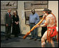 President George W. Bush enjoys a performance of Aboriginal song and dance during a visit Thursday, Sept. 6, 2007, to the Australian National Maritime Museum in Sydney. White House photo by Chris Greenberg