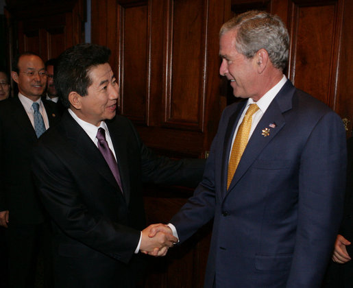 "President George W. Bush welcomes President Roh Moo-hyun of the Republic of Korea, to a meeting Friday, Sept. 7, 2007, at the InterContinental hotel in Sydney. President Bush told his counterpart, "".When we have worked together, we have shown that it's possible to achieve the peace on the Korean Peninsula that the people long for. So thank you, sir."" White House photo by Eric Draper"