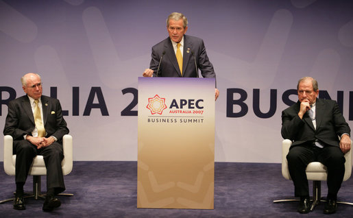 "Flanked by Australia's Prime Minister John Howard, left, and Mark Johnson, Chairman of the APEC Business Advisory Council, President George W. Bush delivers remarks Friday, Sept. 7, 2007, to the APEC Business Summit at the Sydney Opera House. President Bush told his audience, ""America's commitment to the Asia Pacific region was forged in war and sealed in peace. America is committed to the security of the Asia Pacific region, and that commitment is unshakable."" White House photo by Eric Draper"